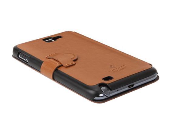 Портмоне SGP Stehen Leather Brown для Galaxy NoteПортмоне Stehen Leather сделано мастерами известной компании SGP вручную из экологичной искусственной кожи высшего качества. Жесткий металлический каркас, скрытый под мягкой микрофиброй и гладкой кожей, гарантировано защитит ваш Galaxy Note от сколов, в...<br>