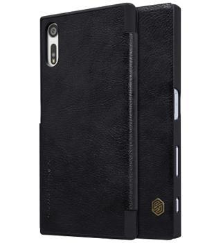 Чехол для Sony Xperia XZs Nillkin Qin case чёрныйПрактичный чехол защищает смартфон при падениях и ударах. Не секрет, что гаджеты часто роняют. Их ремонты стоят недешево. Позаботьтесь об этом заранее — защитите любимый девайс. В этом стильном чехле ваш мобильный гаджет будет долго выглядеть новым.<br>